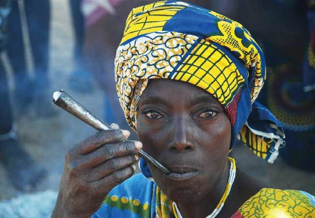 Nguendelengo woman smoking pipe - Angola tours and holidays