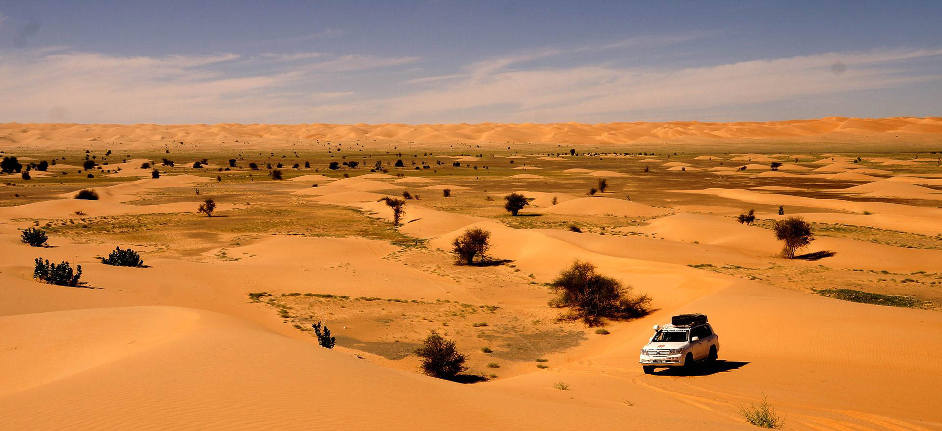 Morocco and Western Sahara Holidays and Tours - 4wd vehicle driving through the desert